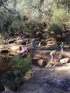 """Macarthur home school children and their parents out and about in the """"classroom'': Ingleburn weir."""