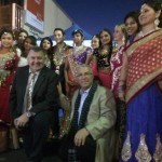 Colour and movement: Mayor Ned Mannoun at the back, with MP Craig Hughes and Councillor Mazhar Hadid at front.