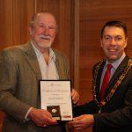 Gerard Bakkers receives his Jubilee Awards certificate from mayor George Brticevic.