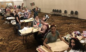Wests staff, Big Yellow Umbrella members and members of the public help sort and wrap more than 100 gifts collected by the Christmas Giving Tree appeal.