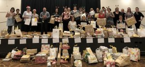 volunteers celebrate completing the big task of wrapping all those presents.