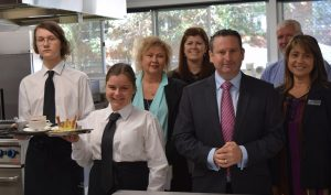 MP Greg Warren, front, is encouraging locals to nominate young achievers for an award.