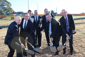 Team work: Local members Bryan Doyle, Jai Rowell, Russell Matheson and Chris Patterson turn the first sod at Narellan Roafd as Mike Baird, Joe Hockey and Tony Abbott watch on.