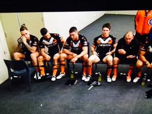 Tough times: the Wests Tigers players in the sheds at half time trailing the Bulldogs 24-nil.